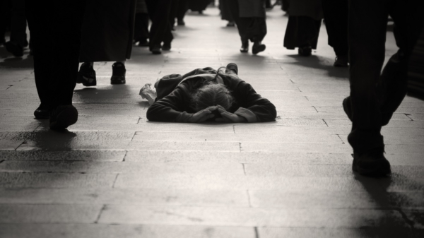 man lying on the street everyone is ignoring him fix your life