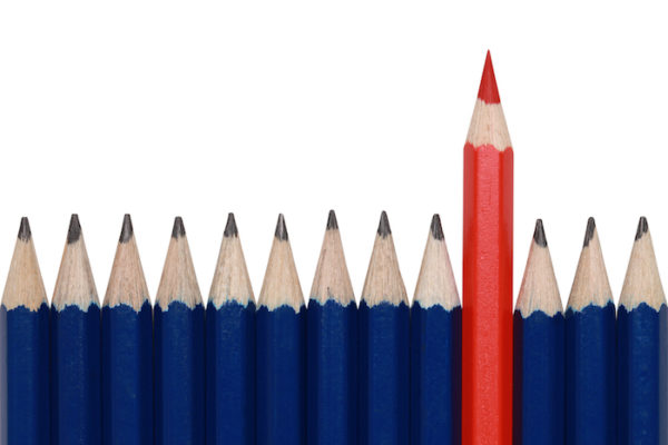 red pencil standing out of a lot of blue pencils sharp